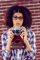 Attractive focused hipster photographing