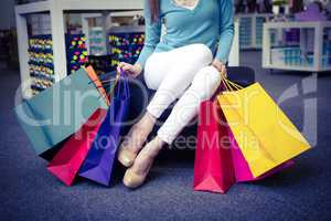 Woman holding many shopping bags