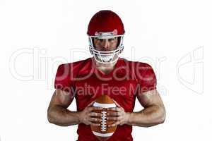 American football player holding ball
