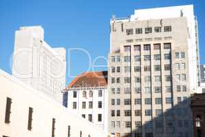 Large buildings against sunny sky