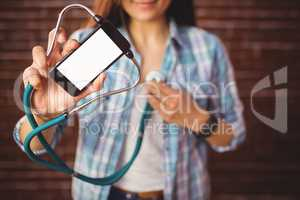 Pretty hipster using her smartphone to diagnose