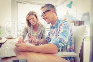 Smiling creative design team working together