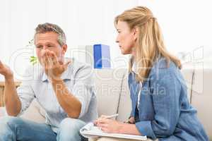 Therapist listening to male patients worries