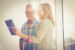 Smiling creative design team using tablet