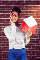 Beautiful smiling hipster holding a big envelope