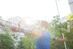 Carefree athlete with arms outstretched