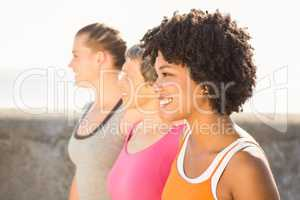 Smiling sporty women looking far away
