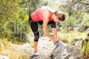 Blonde athlete tying her shoelace