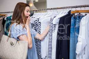 Brunette shocked by price of clothing