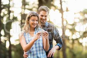 Happy smiling couple looking at pictures