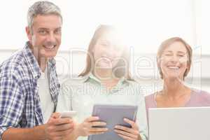 Casual business people with electronic devices