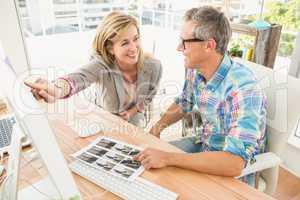 Creative design team working together on computer
