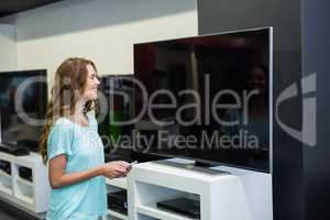 Pretty woman shopping for new television