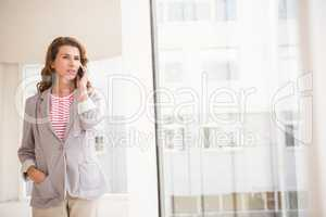 Casual businesswoman having a phone call