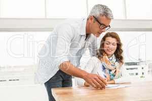 Casual designer briefing his colleague
