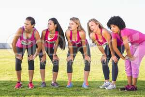 Five focused runners supporting breast cancer marathon