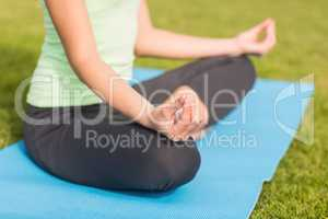 Sporty woman meditating