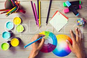 Graphic designer drawing on colour chart