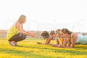 Sporty women planking during fitness class