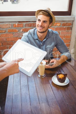 Waitress taking handsome hipsters order with tablet