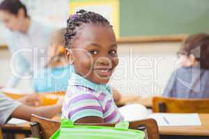 Pupil smiling at camera during class