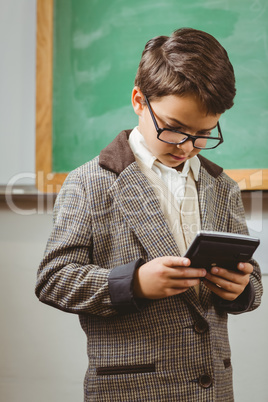 Pupil dressed up as teacher using calculator