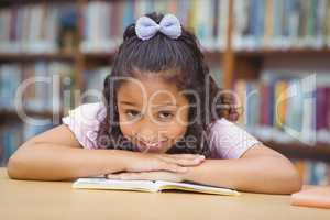 Pupil smiling at camera in library