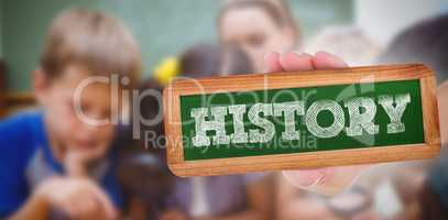 History against cute pupils looking through magnifying glass