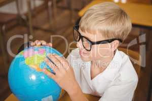 Pupil looking at a globe of earth