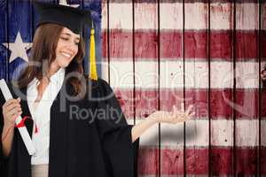 Composite image of a woman holding her hand out with a degree in