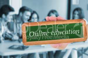 Online education against smiling friends students using laptop