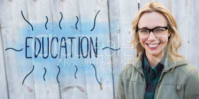 Education against portrait of blonde in glasses posing