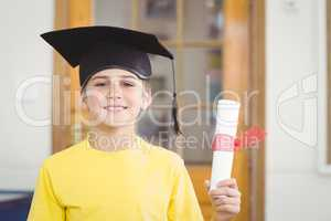 Smiling pupil with mortar board and diploma