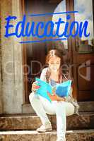 Education against smiling student sitting and reading book