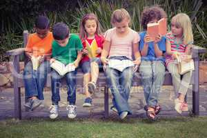Children reading from books together