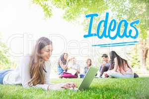 Ideas against happy student using her laptop outside