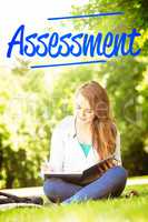 Assessment against smiling university student sitting and writin