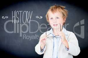 History against boy dressed as teacher in front of black board
