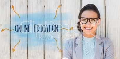 Online education against stylish brunette thinking and smiling