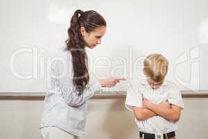 Teacher punishing the bold student