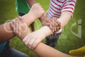 Diverse classmates holding arms