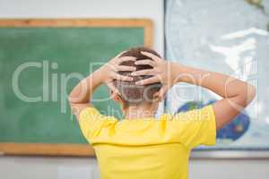 Pupil having hands on head in a classroom