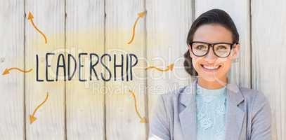 Leadership against stylish brunette thinking and smiling