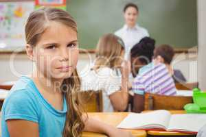 Pupil frowning at camera during class