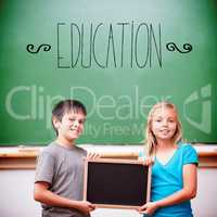 Education against cute pupils showing chalkboard