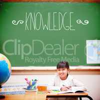 Knowledge against cute pupil sitting at desk