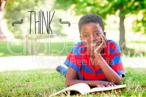 Think against little boy reading in the park