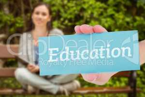 Education against smiling student sitting on bench listening mus