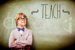 Teach against boy with arms crossed looking up at blackboard