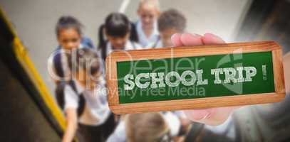 School trip! against cute schoolchildren getting on school bus
